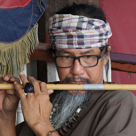 Playing Flute by Eurico David - People Portraits of Men