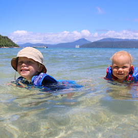 Swimming by Geoffrey Wols - Babies & Children Toddlers ( water, hats, fnq, children, kids, fitzroy island, swimming, life jacket,  )