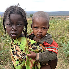 Sister and Brother. by Marcel Cintalan - Babies & Children Children Candids ( sister, children, brother, people, ethiopia, portrait, eyes )
