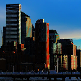 Southern Manhattan Sunset by Finley Delouche - Digital Art Places ( clouds, lightning, tower, one world obervatory, lower manhattan, colorful, sunset, buildings, pier, dark red, architecture, new york city, new york, light )