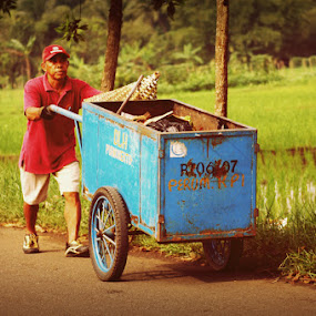 push trash carts by Farizal Syarifudin - People Portraits of Men