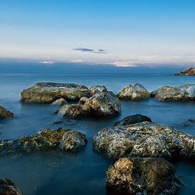 Nettuno Lighthouse by Eric Niko - Landscapes Waterscapes ( exposure, garyfonglandscapes, mare, edition, lighthouse, sea, holiday photo contest, nettuno, long, photocontest, blu, roma, daytime, challenge, d700, italia, 24-70, long exposure, italy, rocks, faro,  )