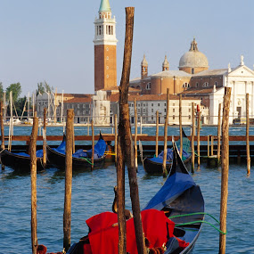 Venetian gondola with Santa Maria Salute in background by Gale Perry - City,  Street & Park  Historic Districts ( gondola, lagoon, piazza san marco, red cover, santa maria salute, parked,  )