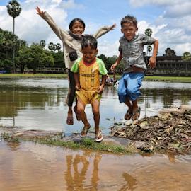 Jump of Joy Cambodian Children by Chuck Kuhn - Babies & Children Children Candids ( #laughter, jumping, #children, angkor wat, cambodia )