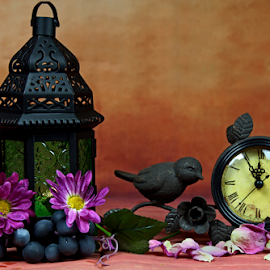 A lantern with a clock still life. by Dipali S - Artistic Objects Still Life ( lantern, clock, petals, grapes, decoration, watch, still life, artistic, beauty, tranquility, flowers )