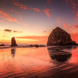 Sunset over Canon Beach by Dana Walker - Landscapes Sunsets & Sunrises ( canon beach, haystack rock, sunset, pacific ocean, reflections, beach, footsteps )