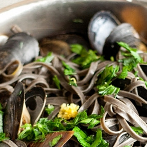 Garlicky Mussels with Squid Ink Linguine