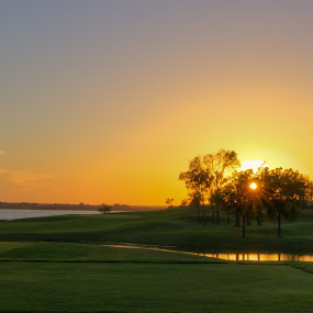 Seventeen by Roger Armstrong - Landscapes Sunsets & Sunrises ( sky, sunset, golf, lake, sun )