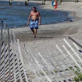 Man On The Beach by Thomas Shaw - People Street & Candids ( water, fence, sand, post, cape look out, blue, ocean, beach, coast, man, north carolina )