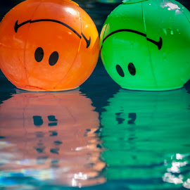 Don't smile! by Maurizio Riccio - Artistic Objects Toys ( reflection, pool, inflatable toys, inflatables, toys, smile )