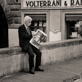 Newspaper reader by Andrija Vrcan - City,  Street & Park  Street Scenes ( black and white, newspaper reader, street,  )