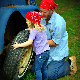 Hard at Work by Tammy Price - People Family ( girl, granddaughter, papaw, working, tire )