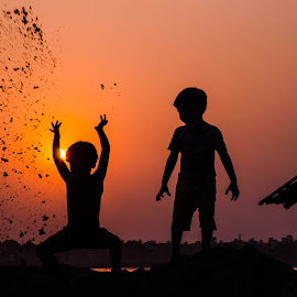 I am playing  by Prosenjit Mukherjee - People Street & Candids ( street, play, action, children, candid, night, people )