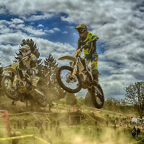 Duelling In The Dusty Air by Marco Bertamé - Sports & Fitness Motorsports ( clouds, speed, yellow, race, jump, dusty, noise, two, flying, motocross, blue, dust, cloudy, grey, duel )