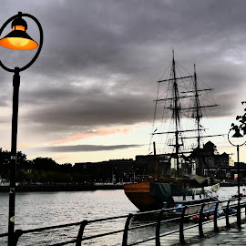The Lantern and the Boat by Jimmy Fitz - City,  Street & Park  Street Scenes ( water, lantern, sky, night time, boat, evening, dusk, city )