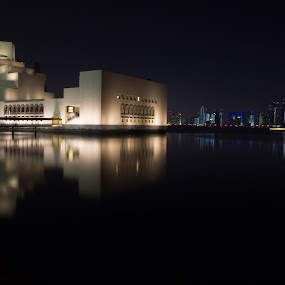 Mirrored by Anthony Schwab - Buildings & Architecture Other Exteriors ( reflection, cities, mia, doha, buildings, qatar, architecture, museum, middle east, museum of islamic art, night, lights )