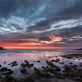 Sunset over sharp rocks by Simon Maddock - Landscapes Waterscapes ( colour, clouds, orange, red, sunset, beach, rocks )