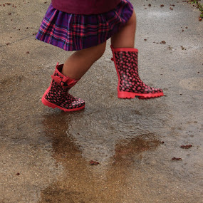 Rain Dancer by Lyle Hatch - Babies & Children Children Candids ( skirt, dancing, patio, cute, concrete, kid, girl, in the rain, raining, plaid, pink, stomping, wet, puddle, cement, boots )
