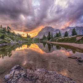 Sunset at lake Limedes by Aleš Krivec - Landscapes Mountains & Hills ( clouds, reflection, mountain panorama, limedes, reflections, lake, forest, sunlight, sun, mountains, sunset, serenity, dolomites, cloudporn )