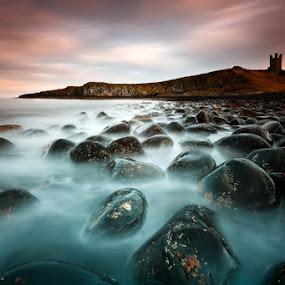 Dunstanburgh Castle by Pete Barnes - Landscapes Beaches ( pebble, hill, smooth, waves, dunstanburgh castle, stone, sea, rock, ocean, beach, travel, seascape, landscape, coast, dunstanburgh, northern, dramatic, weather, long exposure, castle, pete barnes, wet, misty )