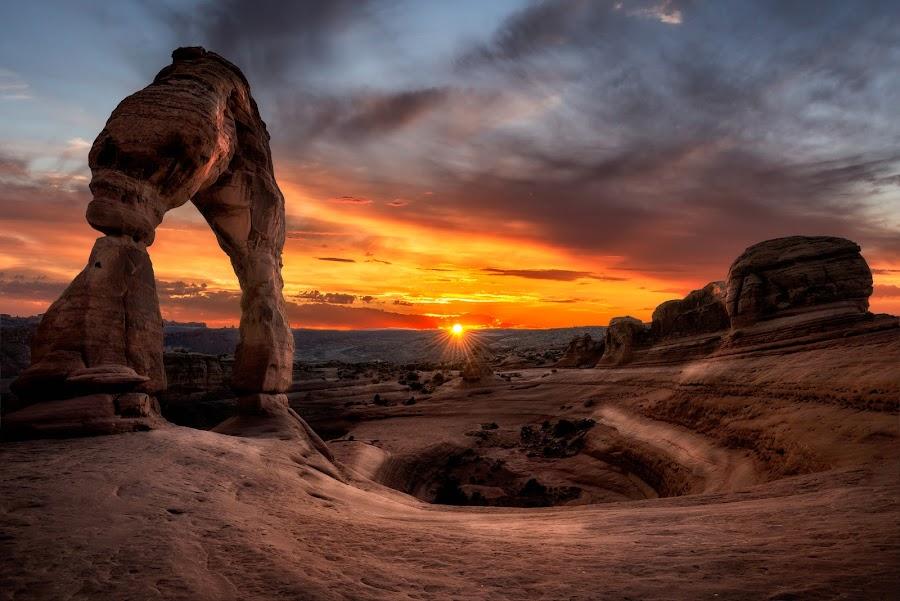 Delicate Sunset by James Bailey - Landscapes Sunsets & Sunrises ( orange, sky, red, arch, utah, blue, sunset, cloud, rock, sun )