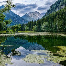 Planšar Lake in Jezersko by Daniel Tomanovič - Landscapes Mountains & Hills ( clouds, reflection, mountain, green, beautiful, lake, travel, landscape, mountains, forrest, nature, slovenija, fujifilm, slovenia, cloudy, summer, trees, karavanke, travel photography )