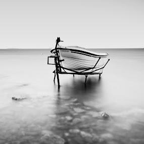 lonely boat by Ömür Kahveci - Transportation Boats ( b&w, waterscape, seascape, boat, longexposure )