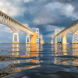 Storm at the Bridge by Carol Ward - Buildings & Architecture Bridges & Suspended Structures ( annapolis, chesapeake bay bridge, between the bridge spans, maryland, reflections, chesapeake bay, architecture, storm clouds, bridge, storm, beneath )
