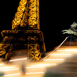 Paris by Night by Gilles De Caevel - Buildings & Architecture Public & Historical ( eiffel tower, paris, horse, night, tourniquet, city at night, street at night, park at night, nightlife, night life, nighttime in the city )