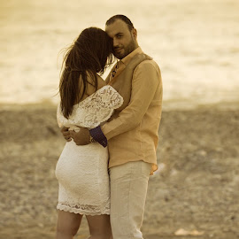 Hold me... by Bassam Khattar - People Couples ( love, sand, hug, sunset, beach, engagement, couples )