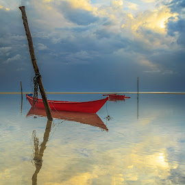 The small red boat. by Daimasala Abdullah - Landscapes Waterscapes ( freedom, travel, house, heat, people, sabah, asian, borneo, sky, village, nature, tourism, malaysia, vacation, horizontal, gypsy, labuan, coral, unique, nomadic, wooden., waterscape, tropical, ocean, beauty, landscape, coast, sun, island, clear, life, happy, sunny, asia, clouds, water, sand, peaceful, romantic, sea, seascape, scenic, crystal, boat, paradise, sunset, background, summer, scenery, sunrise )