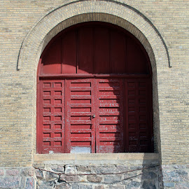 Old Fire Station, Gibbon, Minnesota by Jo Brockberg - Buildings & Architecture Architectural Detail ( old, building, detail, wood, station, brick, stone, door, main street, historic, fire, minnesota, red, shadow, town, day )
