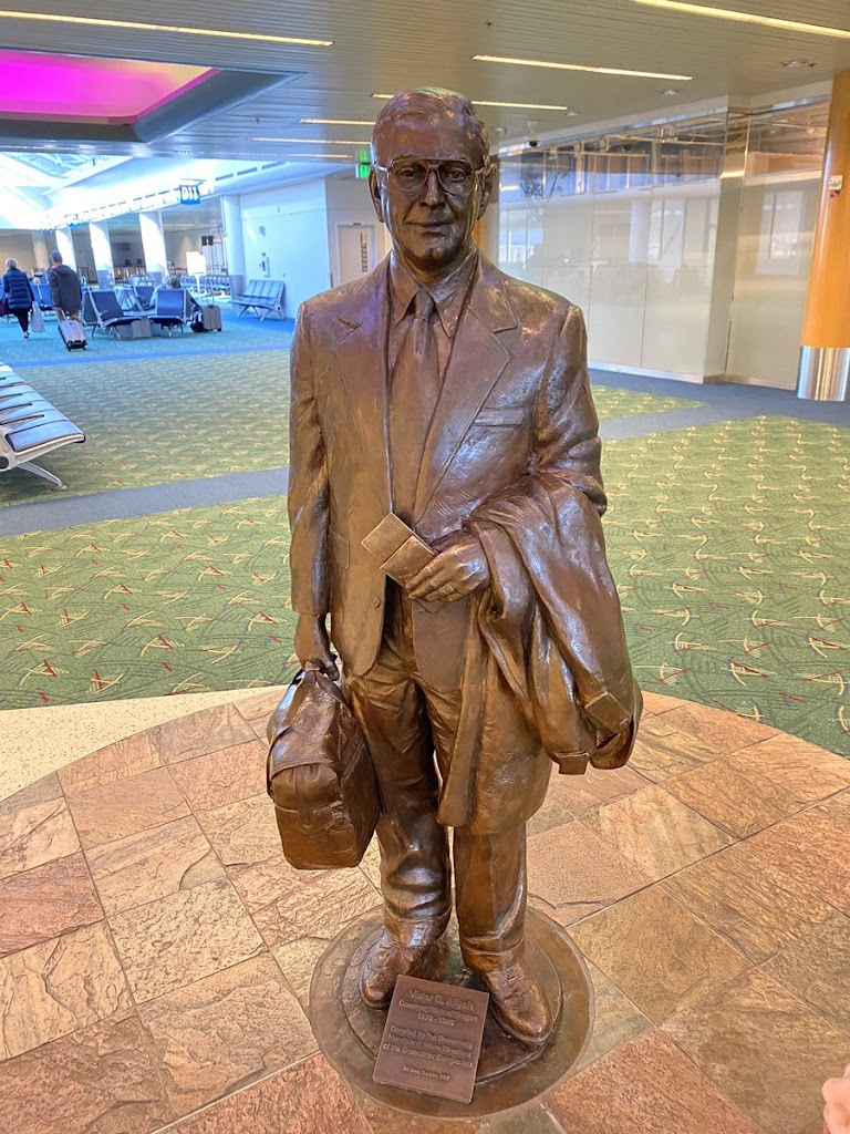 At PDX airport is a bronze statue of former Oregon governor Vic Atiyeh. I noticed a small detail engraved on his boarding pass. Unintentional, or subversive artist? (SSSS means you were