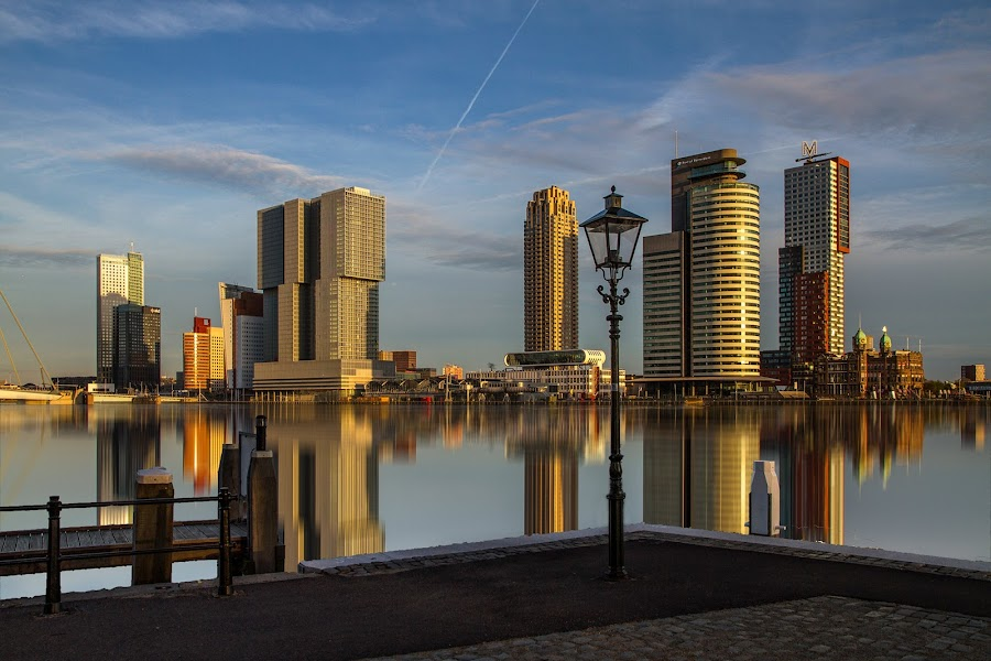 Old lantern and modern buildings by Rémon Lourier - City,  Street & Park  Skylines ( mirrored reflections, colourfull, lantern, highrise, reflection, riverside, rotterdam, holland, dutch, cityscape, river )