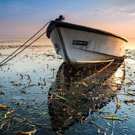 resting by Van Hanafi - Transportation Boats ( #pantaikarang #olympus #transportation #sunrise #beach #bali #indonesia )