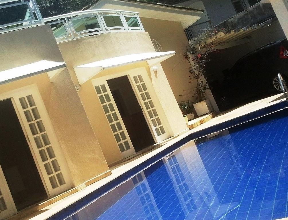 Sobrado com 4 dormitórios à venda, 281 m² por R$ 690.000,00 - Vila Maia - Guarujá/SP