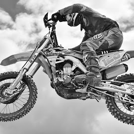 Fly By ! by Marco Bertamé - Black & White Sports ( clouds, 128, fly by, wheel, speed, number, race, noise, jump, flying, sky, motocross, cloudy, air, high )