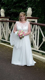 Claire wearing wedding dress 'EM134'.