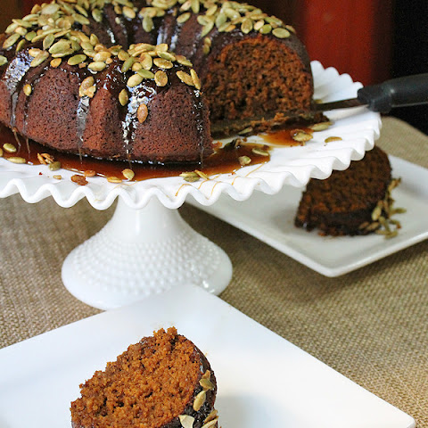 Oatmeal-Molasses Pumpkin Cake with Caramel Glaze and Candied Pumpkin Seed Topping