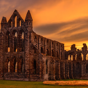 Sunset at the Abbey by Darrell Evans - Buildings & Architecture Public & Historical ( clouds, augustinian monastery, old, building, remains, grass, priory, green, stone, whitby abbey, whitby, landscape, augustinian, sky, yorkshire, sunset, outdoor, monastery, abbey )