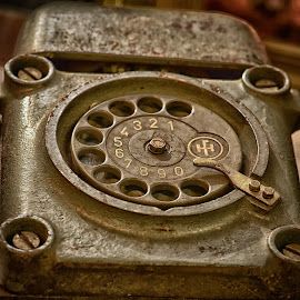 Ruggedized Telephone by Marco Bertamé - Artistic Objects Antiques ( old, vintage, screw, number, round, circle, steel, 3, havy duty, bell, 2, 1, 0, 7, 6, 5, 4, 9, 8, telephone, dial plate )