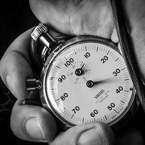 Praying for the end of time. by Bogdan Rusu - Black & White Objects & Still Life ( hand, countdown, black and white, watch, moody )