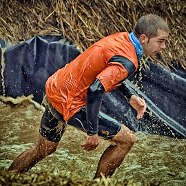 Out Of The Water ! by Marco Bertamé - Sports & Fitness Other Sports ( water, differdange, splash, splatter, 2015, soup, running, luxembourg, muddy, blue, strong, drops, brown, strongmanrun, man, orwange )