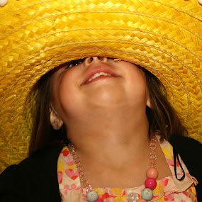 Mexicana by Martin Burnett - Babies & Children Children Candids ( laugh, chin, mexico, yellow, fun, teeth, spain, hat, child, holiday, hand, girl, bobbles, sombrero, lanzarote, smile )
