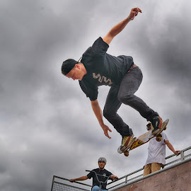 In The Half Pipe by Marco Bertamé - Sports & Fitness Skateboarding ( clouds, skateboarding, half pipe, skater, cloudy, grey, stunt, skateboard )