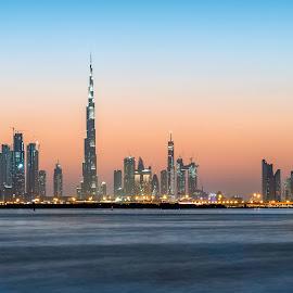 Dubai at Sunset by Sergiu Chirilov - City,  Street & Park  Skylines ( skyline, building, warm, dubai, blue hour, sunset, cityscape, travel, nikon, burj khalifa )