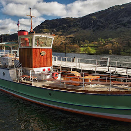 Ullswater, one of my favourite  places in the Lakes, great walks, fantastic scenery and also lovely boat trips from Glenridding to Pooley Bridge or vice versa.  In my opinion the pleasure craft are some of the best in the National Park.  Here's a bit of the Ullswater scenery with the Western Belle tied up at Glenriddding Pier. by Alex Bradley - Transportation Boats