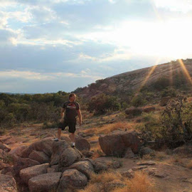 In the distance  by Rachel Kennedy - Landscapes Caves & Formations ( adventure, enchanted rock, sunsut )