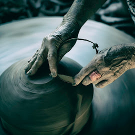 Working by Duc Truc Nguyen - Uncategorized All Uncategorized ( clay, work, hand, hands, pottery, round, earth, pot )