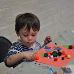 Glue + pom-poms & paper = artistic fine motor masterpieces!